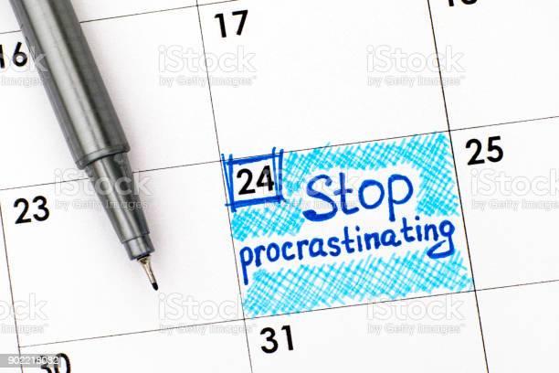 Reminder stop procrastinating in calendar with pen closeup picture id902218082?b=1&k=6&m=902218082&s=612x612&h=np qoacojubb862numpwirjiqddyfdrhhn8ipzyrsru=
