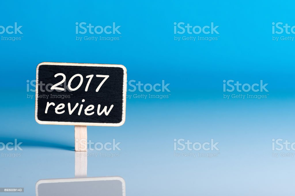 Reminder to prepare an annual report - 2017 review. New year 2018 - Time to summarize and plan goals for the next year. Business background, mockup stock photo