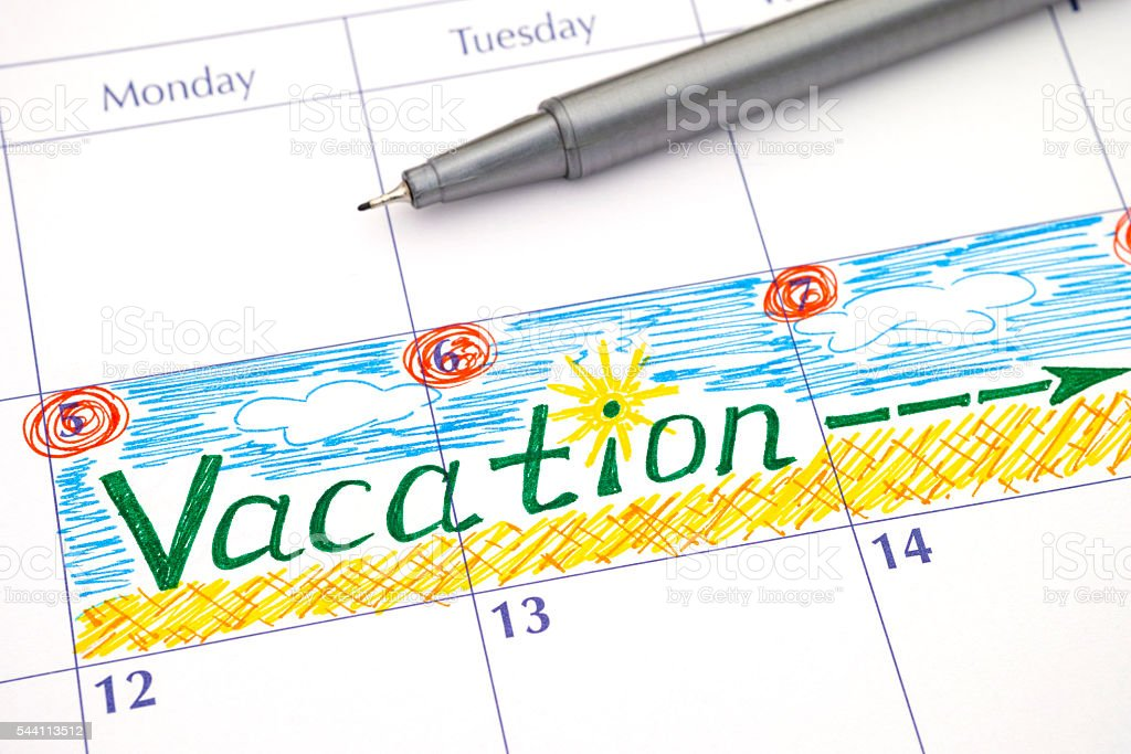 Reminder Vacation in calendar - foto de stock