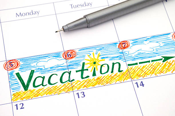 Reminder Vacation in calendar - foto stock