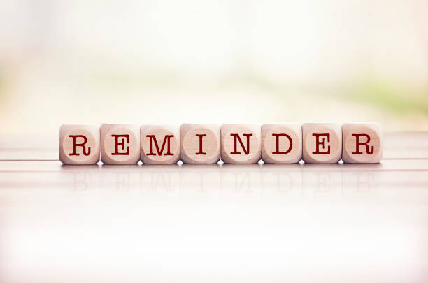 reminder written on cube wooden blocks. - reminder stock photos and pictures