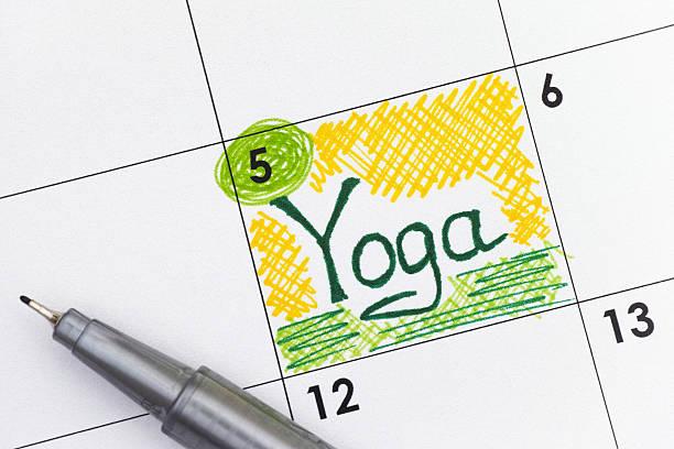 reminder yoga in calendar with pen - calendar workout bildbanksfoton och bilder