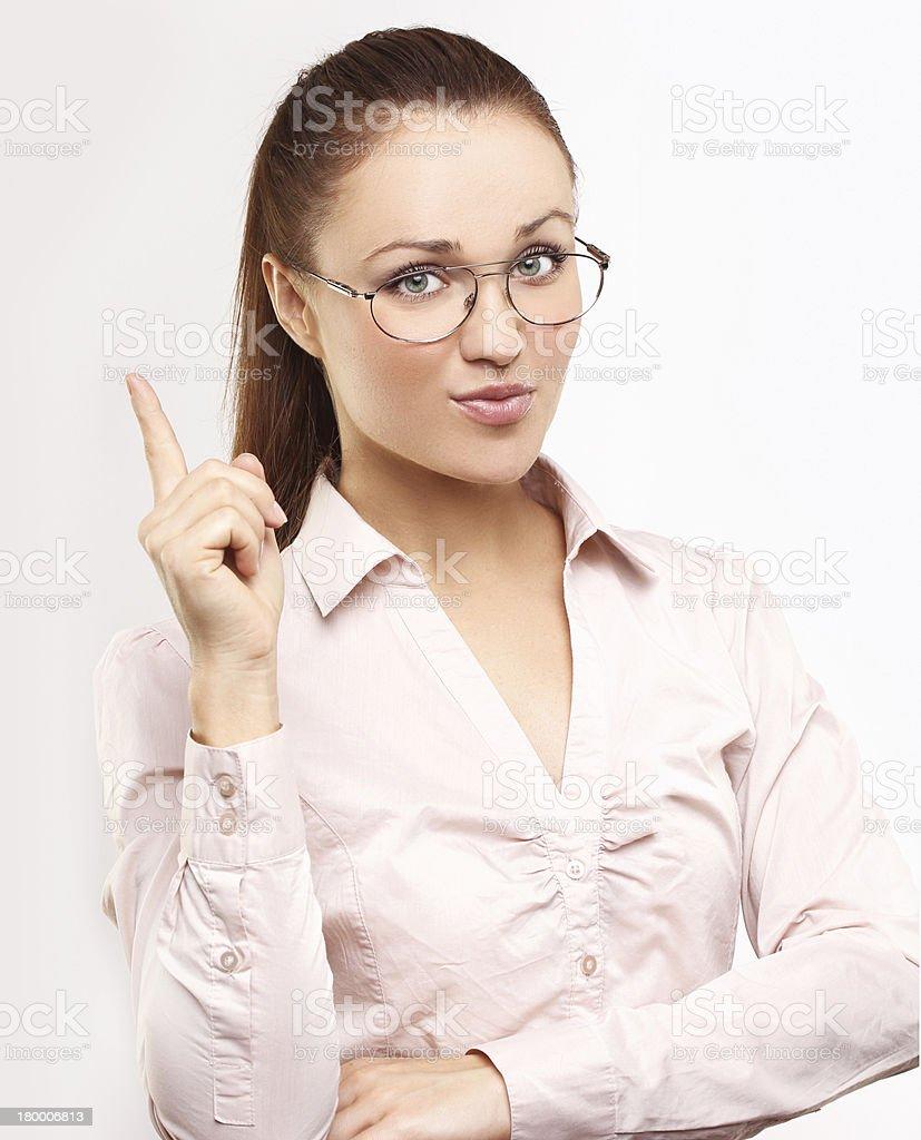 Reminder.Smiling 가리키는 여성 복사 공간이 있습니다. royalty-free 스톡 사진