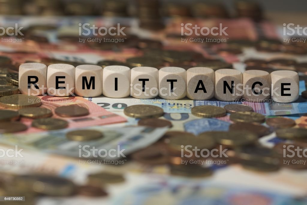 remittance - cube with letters, money sector terms - sign with wooden cubes stock photo