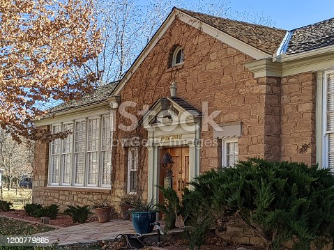 Remnant wing of old stone building and historic schoolhouse of Rockville Utah about 100 years ago now restored