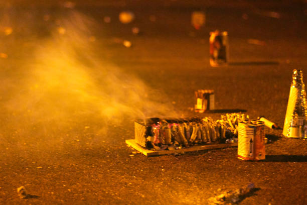 Remnants of burnt pyrotechnics firecrackers on the road stock photo