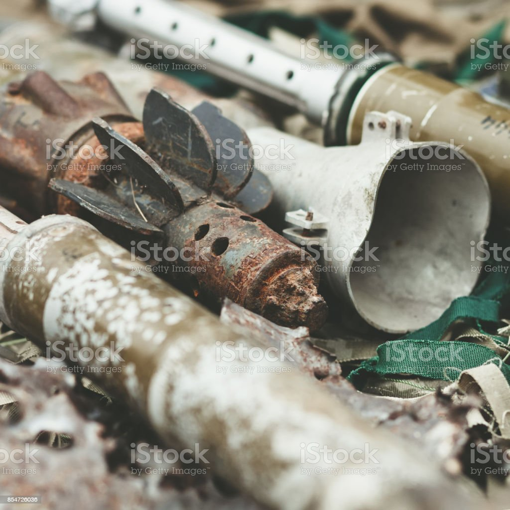 remnants of shells anti-tank rocket propelled grenade launcher and High Mobility Artillery Rocket System stock photo