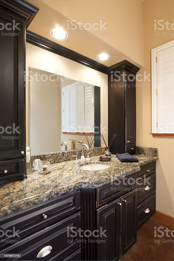 Remodeled bathroom with dark cabinets and granite countertop royalty-free stock photo