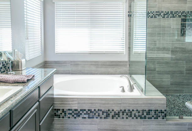 remodeled modern bathroom - bathroom renovation stock photos and pictures