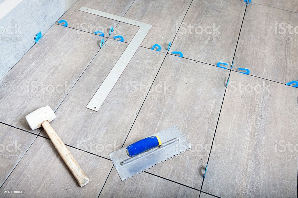 Remodeling Constuction Tiling Floor with Ceramic Tiles stock photo