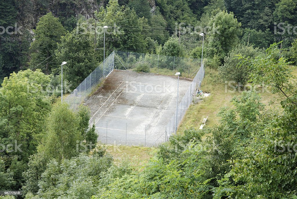 remote and ruinous tennis court royalty-free stock photo