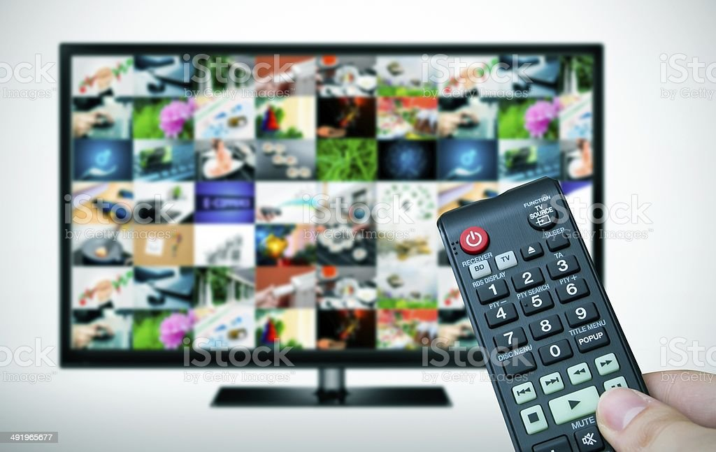 Remote and TV with multiple images gallery stock photo