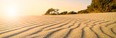 Remote beach at sunset panoramic with sand ripples from the wind in Turkey