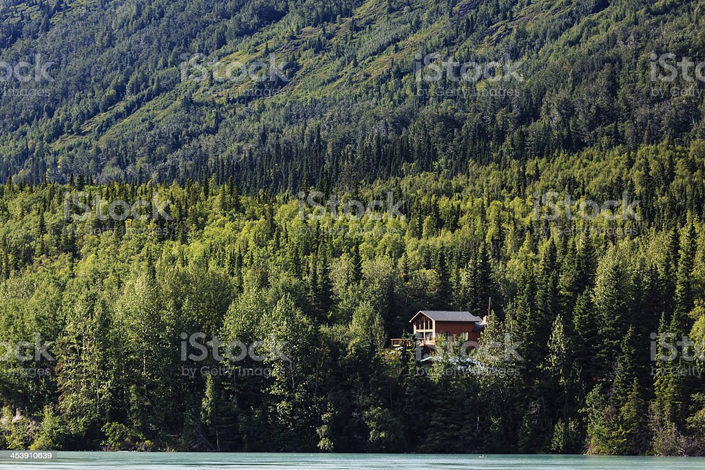 Remote cabin in the Alaskan wilderness during summertime stock photo