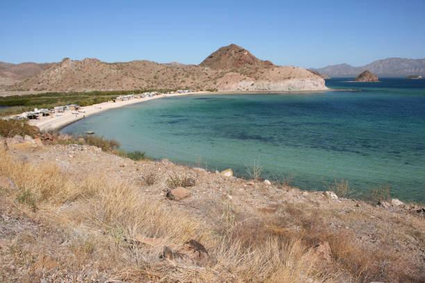 Remote camping on Playa Santispac, Baja California Sur, Mexico stock photo