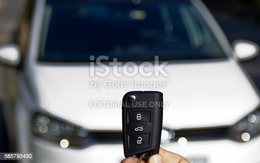 Istanbul, Turkey - July 30, 2016: There is a man opening the volkswagen polo with its key in a sunny day in istanbul.