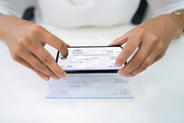 Remote Check Deposit Using Phone stock photo