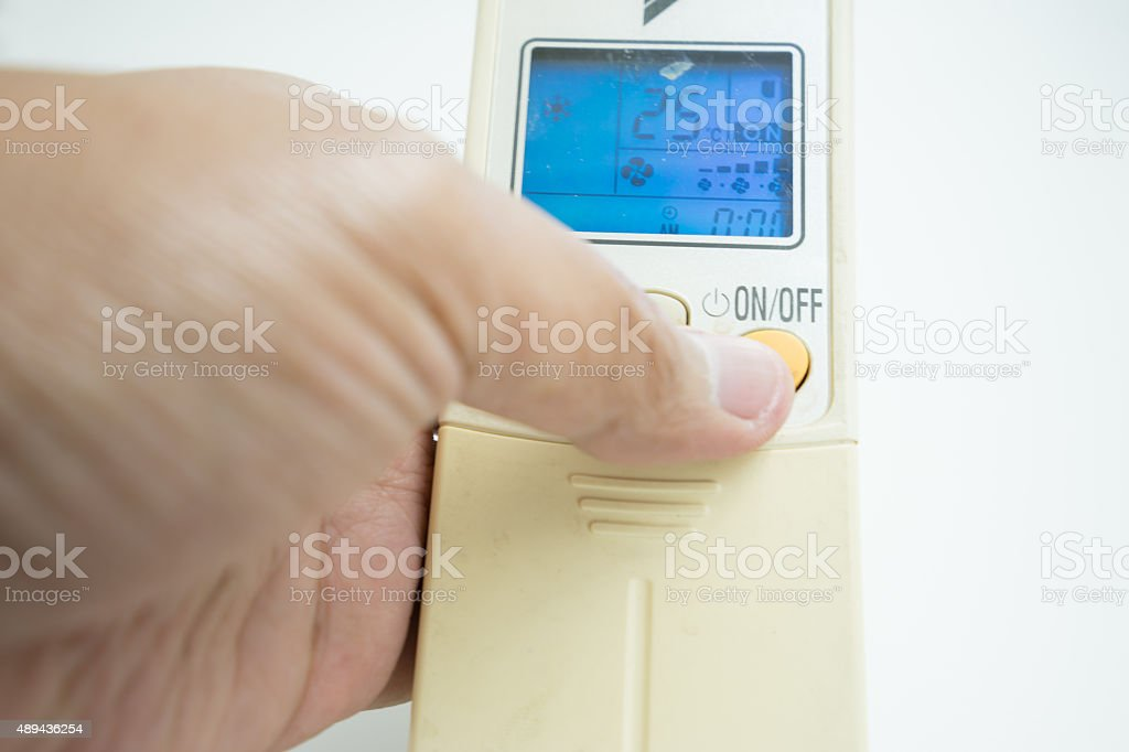 remote control air conditioner switch off reduce energy. stock photo