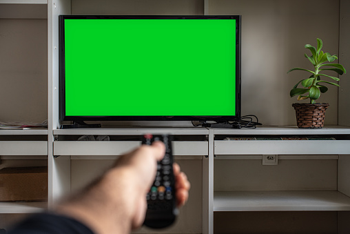 Pointing remote control towards a TV at home- Chroma Key