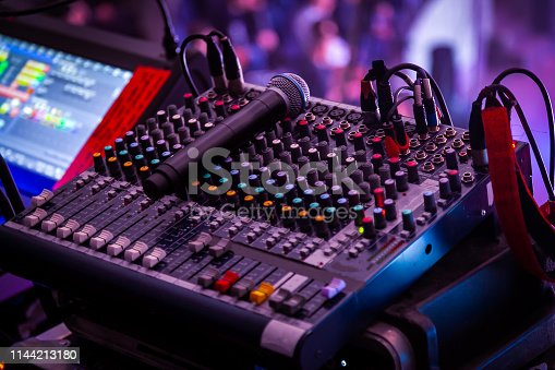 Night club, the concept of nightlife and theatrical life. Professional mixing console at a concert. Remote control for sound engineer. Work place of sound producer at the event