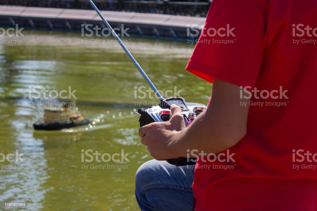 Remote control for sports model in the hands of boy. Hobby