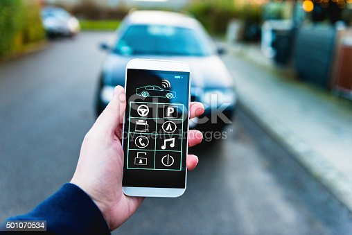 istock Remote control of car with app on mobile phone 501070534