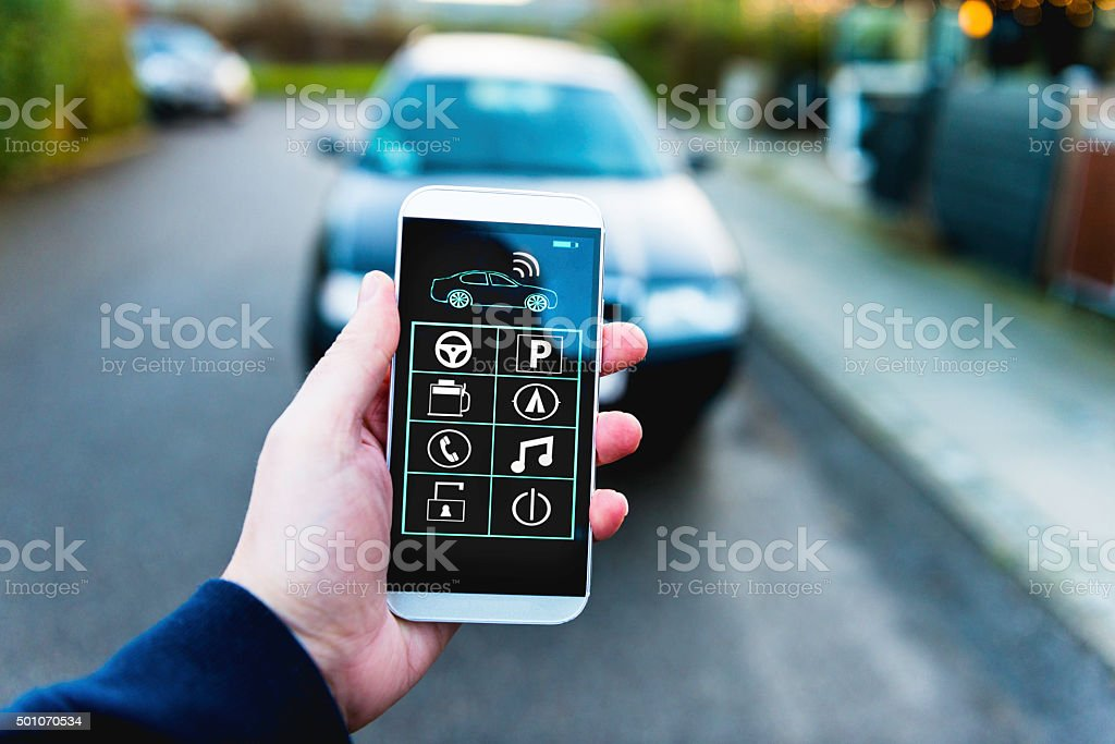 Remote control of car with app on mobile phone stock photo