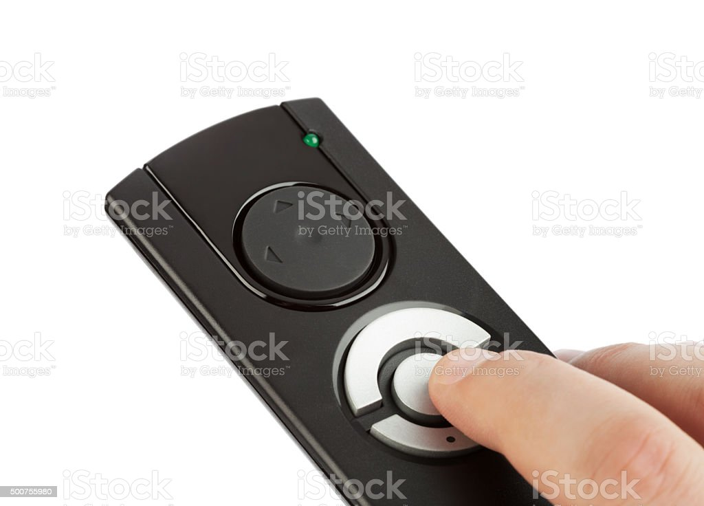 Remote control with blank buttons in hand stock photo