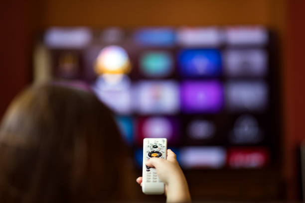 Remote control with smart tv stock photo