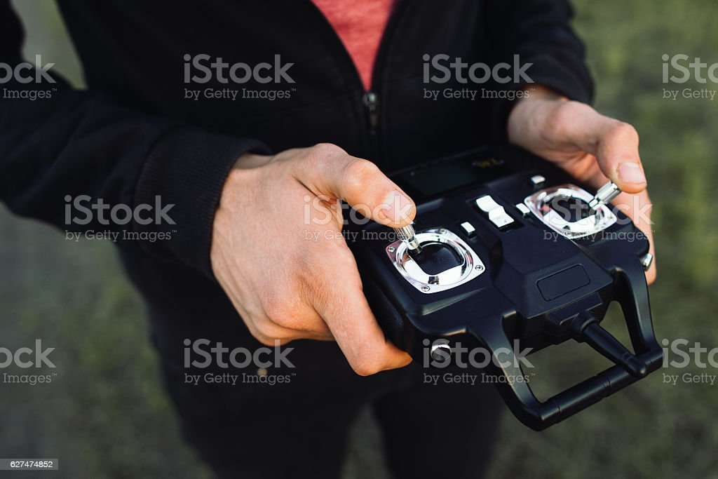 Remote controller in male hands close-up stock photo