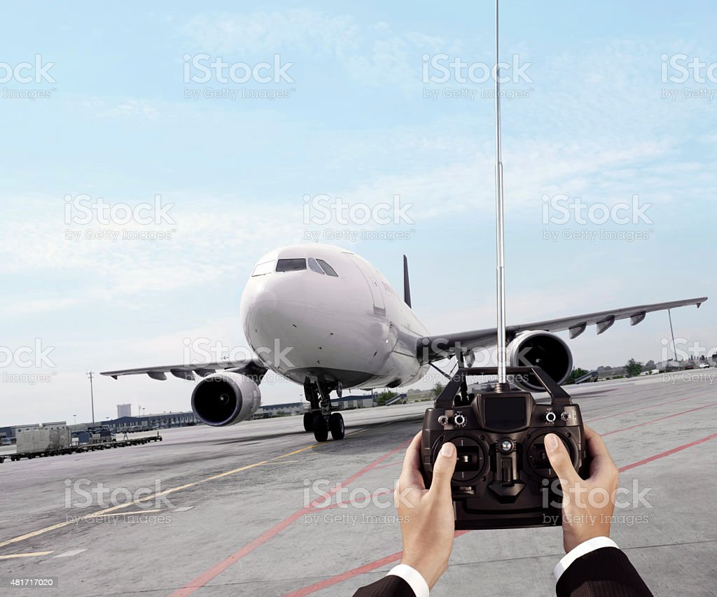 remote controlling passenger plane stock photo