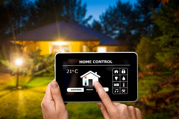 remote home control system on a digital tablet. - home automation stock photos and pictures