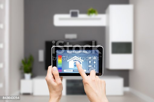 istock Remote home control system on a digital tablet. 843643254