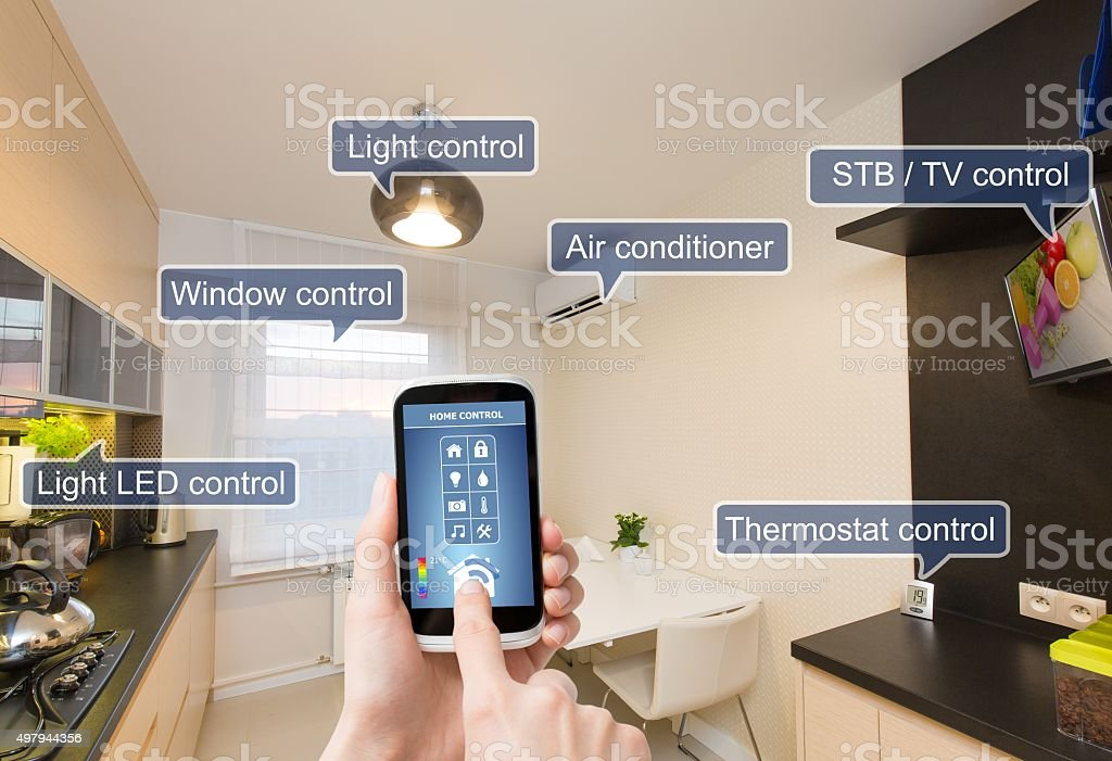 Remote home control system on a smart phone. stock photo