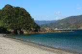 Remote island sandy beach and sea
