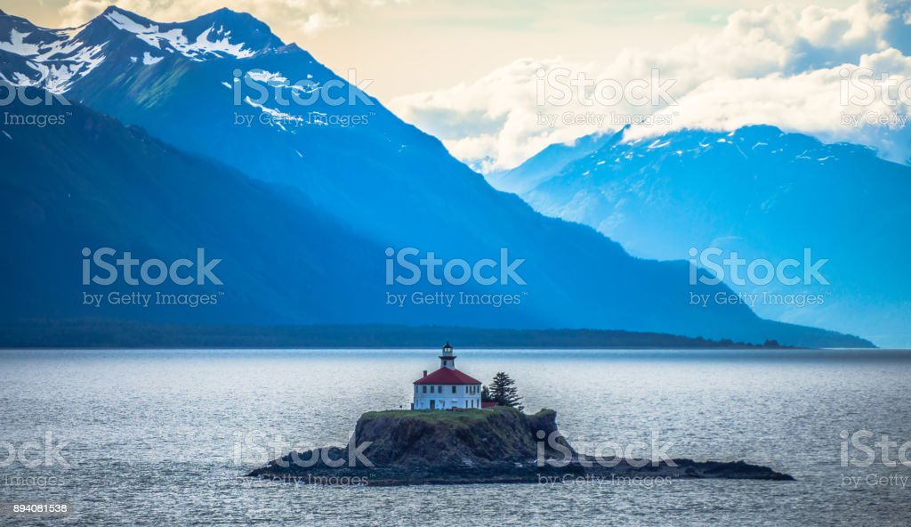 remote lighthouse island standing in the middle of mud bay alaska stock photo