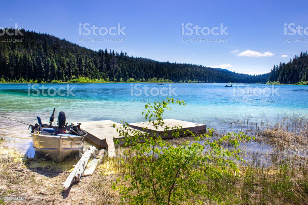 Remote Mountain Fly Fishing Turquoise Lake in the Forest royalty-free stock photo