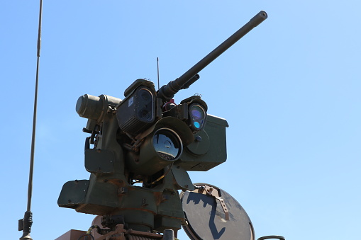 Remote operated machine gun on a military vehicle