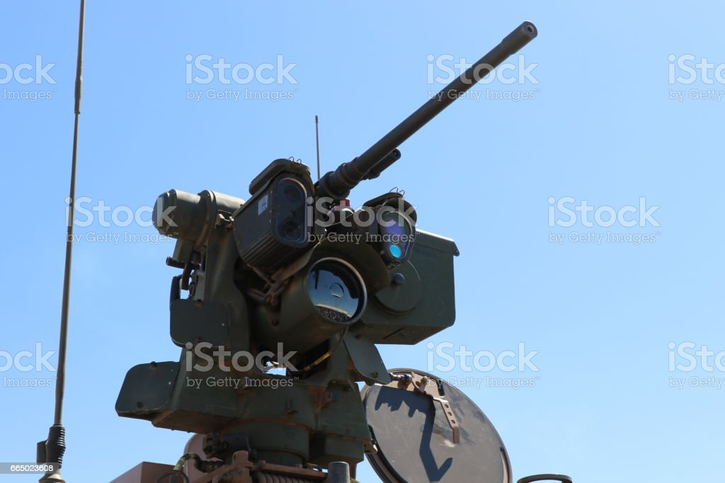 Remote operated machine gun on a military vehicle stock photo