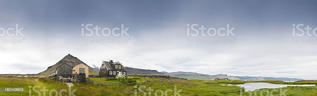 Remote rural home tranquil summer Arctic coast fjord panorama Iceland stock photo