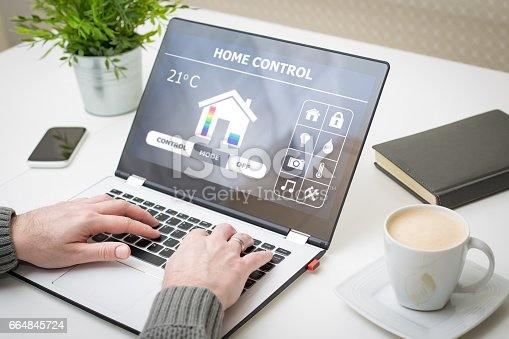 istock Remote smart home control system on a laptop. 664845724