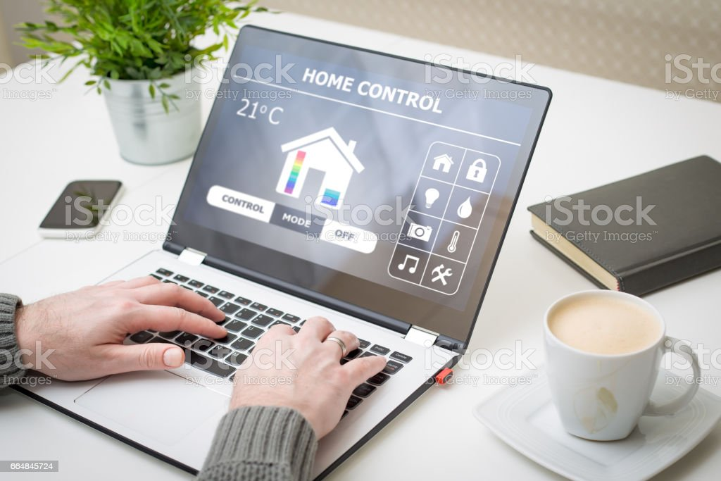 Remote smart home control system on a laptop. stock photo