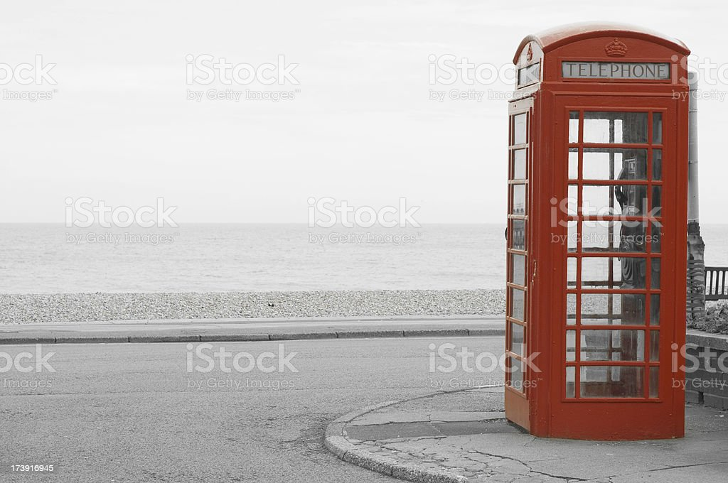 remote telephone booth near the ocean royalty-free stock photo