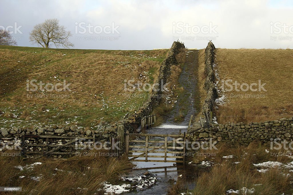 remote track and gate in countryside royalty-free stock photo