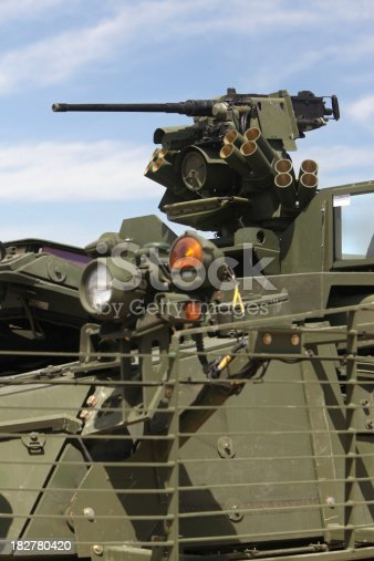 M2 .50 caliber machine gun and grenade launcher mounted on U.S. Army M1126 infantry carrier vehicle.
