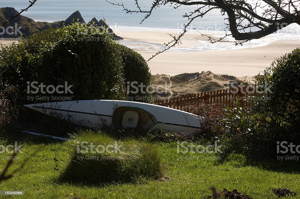 Remote Welsh beach canoe royalty-free stock photo