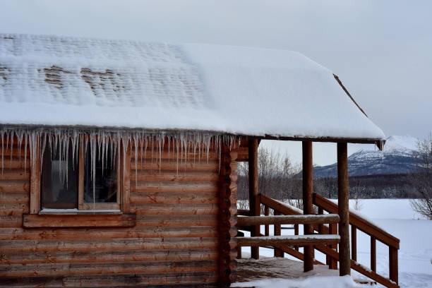 Remote winter cabin stock photo