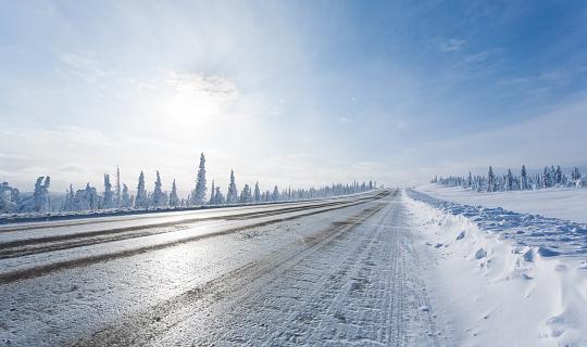 Straight Icy Winter Road in Alaska's  Arctic Wilderness