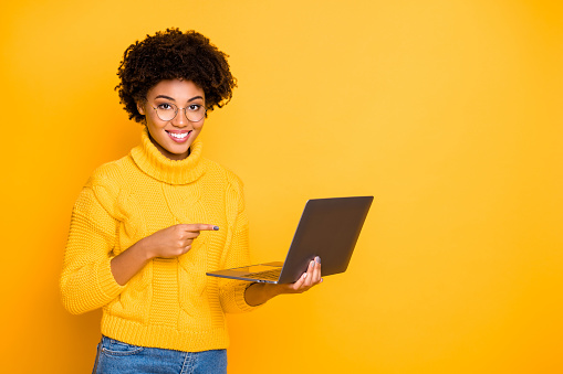 istock Remote work concept. Photo of clever experienced girl looking for teacher tutor on web-page want to learn, study via internet and recommend you to do the same holding using netbook isolated background 1175501574