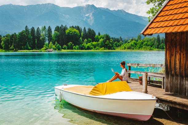 Remote Working and Enjoying Bleisure Time at Lake Faak in Austria stock photo